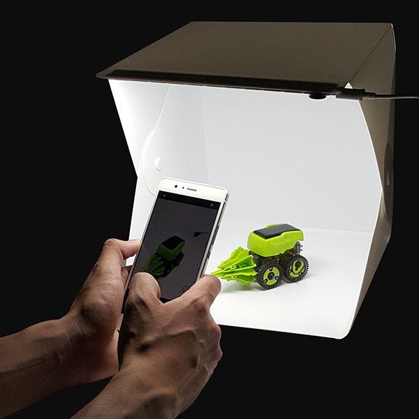 Mini estudio fotográfico ideal para tomar fotografías profesionales, con excelente iluminación, diseño compacto y portable.